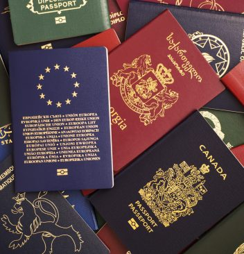 Mixed biometric passports of many countries of the world. In the foreground is a European Union passport.